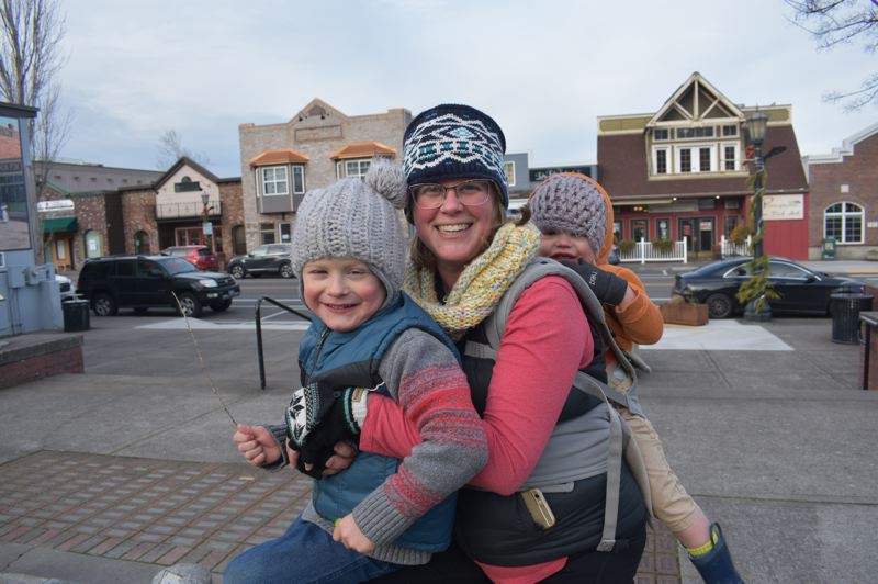 PMG PHOTO: SHANNON O. WELLS - Troutdale Councilor Jamie Kranz takes a break from a busy home and volunteer life with her sons Boone, left, and Zane at Mayors Square in downtown Troutdale.