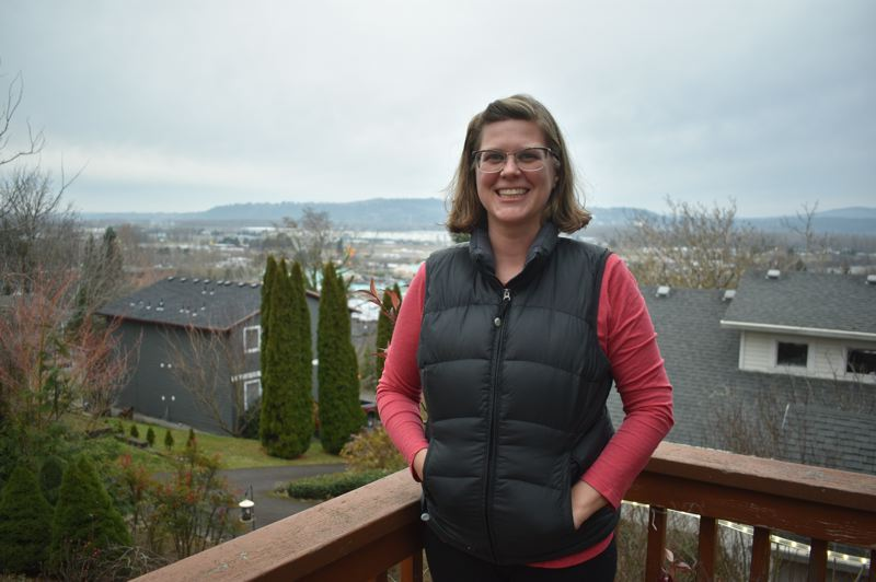 PMG PHOTO: SHANNON O. WELLS - Jamie Kranz, pictured on her deck overlooking downtown Troutdale and the Amazon Fulfillment Center, jumped head first in Troutdale politics, serving on two city committees and successfully running for City Council in 2018.