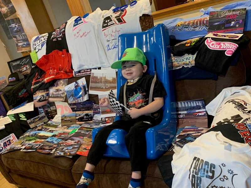 SUBMITTED PHOTO - The top fifth story of 2019 was how a 4-year-old boy named Ezra Thomas captured the hearts of Jefferson County residents. Ezra suffered a traumatic brain injury at the age of 2 1/2, due to abuse by his mother's former boyfriend. The story shed light on child abuse and his resilience.The love for Ezra has continued and now racers from across the U.S. and Canada flooded the boy with racing hero cards, cars and more.