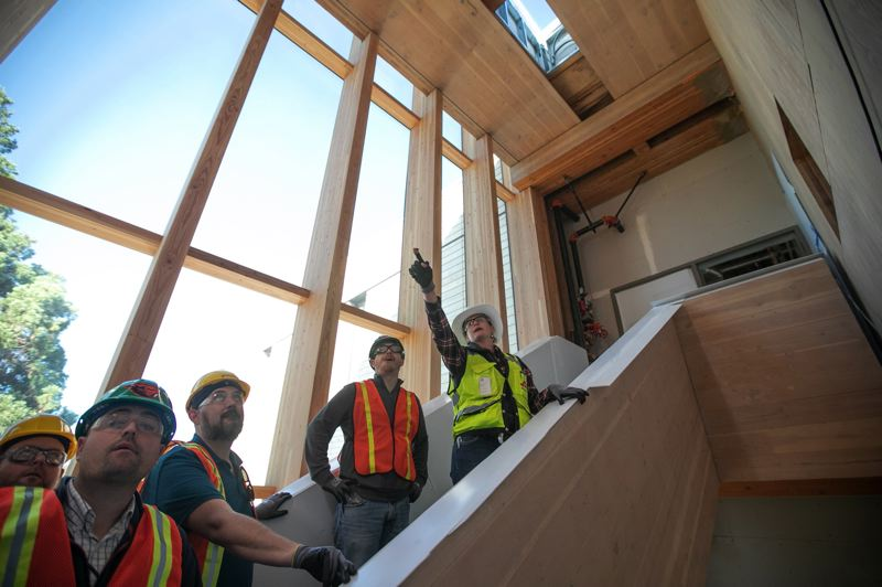 PMG FILE PHOTO - Juliana Ruble, project engineer with Andersen Construction leads a tour inside the George W. Peavy Forest Science Center. When completed, the building on the Oregon State University campus in Corvallis will be a showcase for mass timber products.