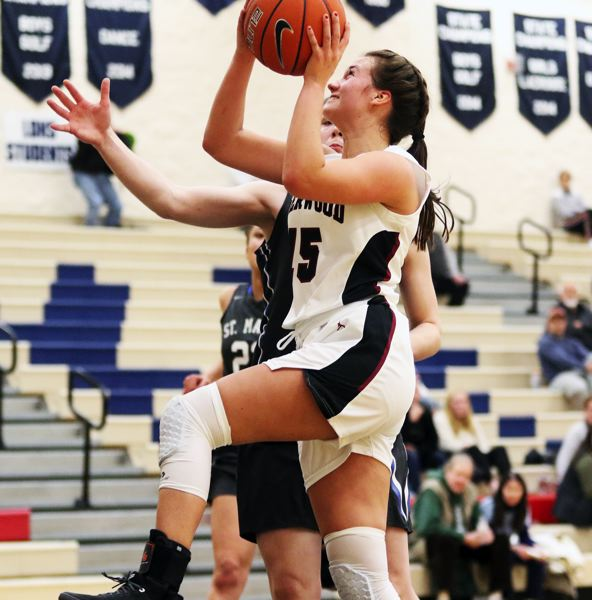 PMG PHOTO: DAN BROOD - Sherwood High School sophomore Amanda Jensen goes up to the basket during the Lady Bowmen's game against St. Mary's at the Nike Interstate Shootout.
