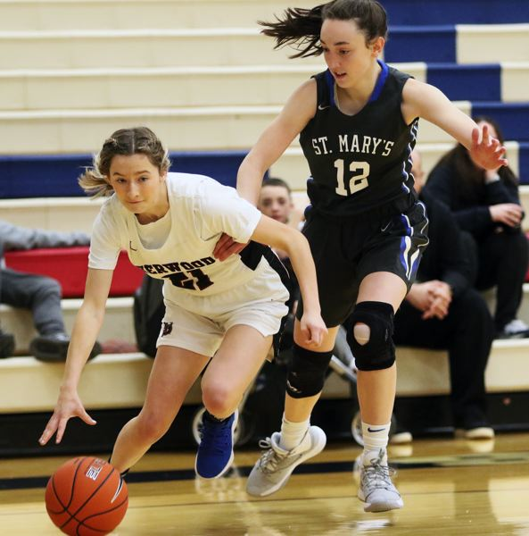 PMG PHOTO: DAN BROOD - Sherwood High School senior senior guard Ava Boughey (left) looks to dribble past St. Mary's senior Anna Eddy during the fourth-place game at the Nike Interstate Shootout.