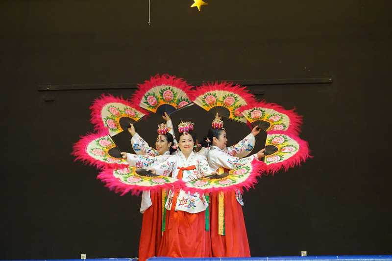 PMG FILE PHOTO - Dancers from the Oregon Korean Performing Arts Troupe create many beautiful images throughout the traditional Korean fan dance at Forest Hills Elementary in January.