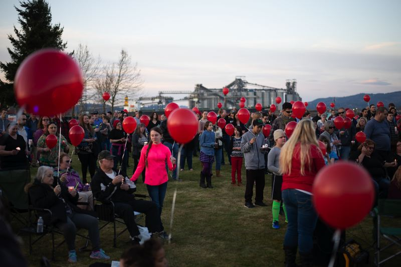 PMG PHOTO: ANNA DEL SAVIO - Community members gathered in Rainier in March for a vigil after the unexpected death of 18-year-old Sarah Zuber. Attendees released red ballons, the same color as the hat Zuber wore frequently.