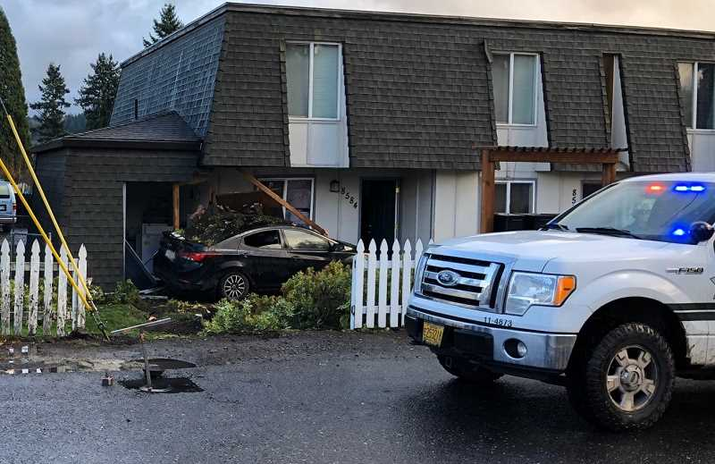 COURTESY PHOTO: CCSO - Near Southeast 72nd Avenue and Clatsop Street, police say a woman driving a Hyundai Elantra at a high rate of speed drove off the road and collided into an apartment building.