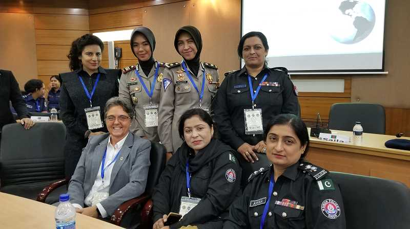 COURTESY OF WOODBURN POLICE - Woodburn Police Det. Linda Hedricks shared experiences with female law-enforcement counterparts overseas during a visit to Bangladesh to participate in the International Criminal Investigative Training Assistance Program.