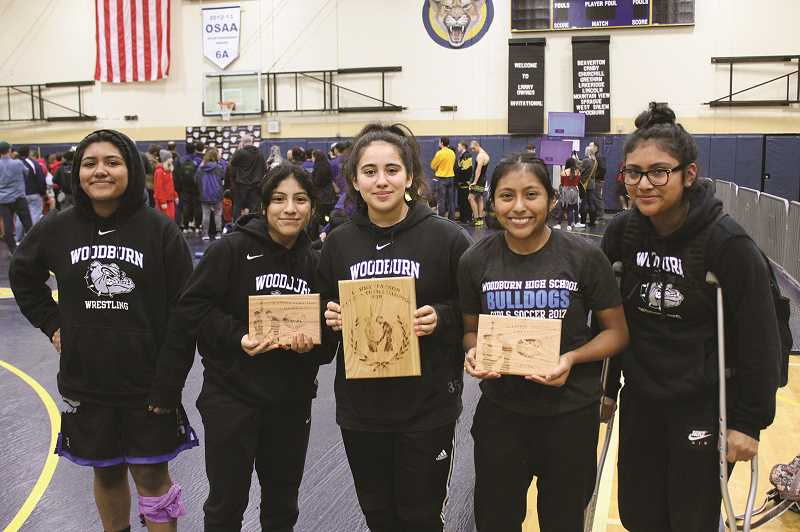 COURTESY: WOODBURN WRESTLING - The Woodburn girls wrestling team placed first at the Larry Owings Invitational, led by individual champions Yajaira Reyes and Angie Lopez.