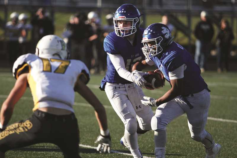 PMG FILE PHOTO - St. Paul quarterback T.J. Crawford (middle) was named 1A Co-Player of the Year, while backfield teammate Saul Martinez (right) was a First Team All-State honoree on both offense and defense.