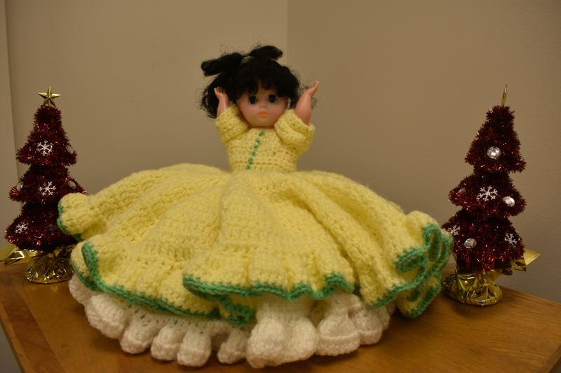 PMG PHOTO: SHANNON O. WELLS - A doll Gresham resident Jere Hudson found a couple days after Christmas in Wood Village is notable for its intricately crocheted yellow dress.