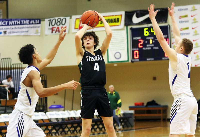 PMG PHOTO: DAN BROOD - Tigard High School junior Brett Moss (4) goes up for a shot during the first quarter of the Tigers' 85-78 win over Western Christian Thursday at the Les Schwab Invitational The Eight tourney.
