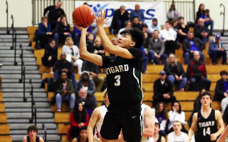 PMG PHOTO: DAN BROOD - Tigard High School senior Steven Long goes up to the basket during the Tigers' 85-78 win over Western Christian on Thursday.