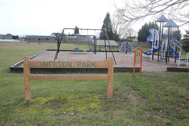 PMG PHOTO: JUSTIN MUCH - Neighborhood park and green area, Nelson Park. Woodburn is bringing back an Adopt-A-Park program to help keep city playgrounds and green areas looking sharp.