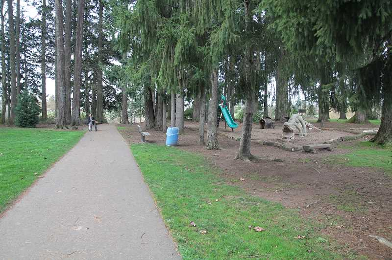 PMG PHOTO: JUSTIN MUCH - Legion Park is a veritable multipurpose area with trails, playgrounds, wooded space, open space, ball fields, a venerable stadium and a shelter. Woodburn is bringing back an Adopt-A-Park program to help keep city playgrounds and green areas looking sharp.