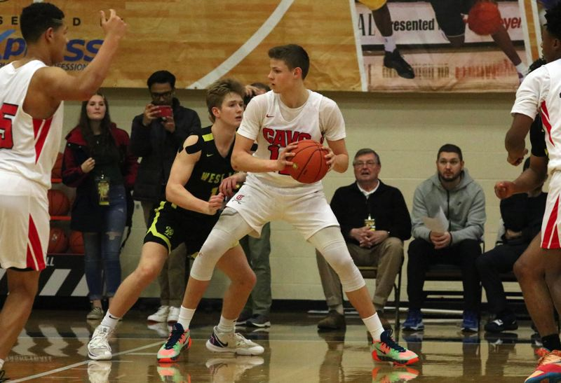PMG PHOTO: JIM BESEDA - Clackamas' Ben Gregg was named to the Les Schwab Invitational's all-tournament team after leading the Cavaliers to a 75-60 win over West Linn in the consolation final at Liberty High School.