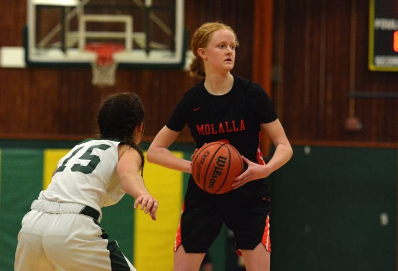 PMG PHOTO: DEREK WILEY - Hannah Nelzen's rebounding was key for Molalla during holiday tournaments at Sisters and Banks high schools.