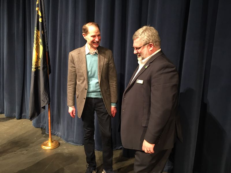 PMG PHOTO BY PETER WONG - U.S. Sen. Ron Wyden, left, and Tigard Mayor Jason Snider chat after Wyden appeared Sunday, Jan. 5, at a town hall meeting at Tigard High School.