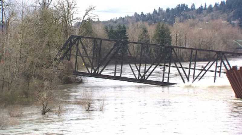 PMG FILE PHOTO - Union Pacific's abandoned trolley bridge crossing the Clackamas River between Gladstone and Oregon City collapsed in 2014.