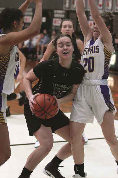 PMG PHOTO: PHIL HAWKINS - North Marion sophomore Mallory Patzer works in the trenches against the Gervais Cougars in the tournament semifinals on Friday. The Huskies handed Gervais their first loss of the season, 31-28.