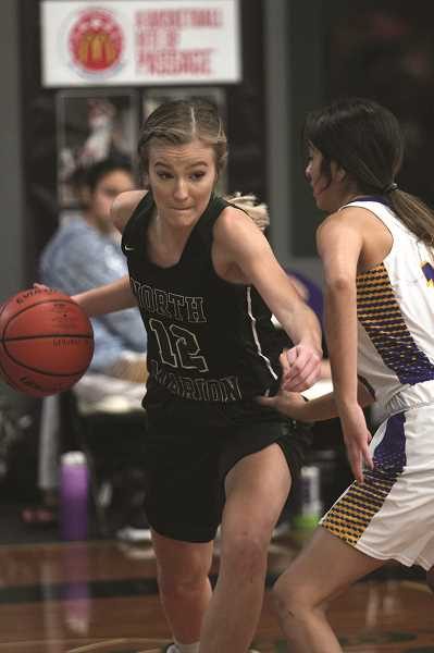 PMG PHOTO: PHIL HAWKINS - North Marion senior Katie Ensign led the Huskies in scoring in their final two games of the Salem Academy tournament, putting up 10 against Gervais on Friday and going for 17 in the Black Bracket title game against Horizon Christian on Saturday.