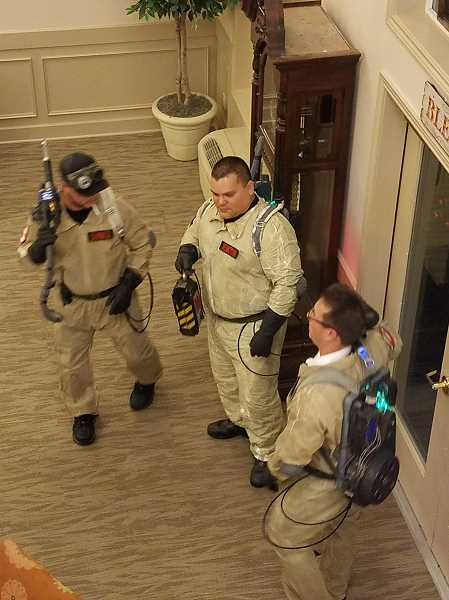 COURTESY PHOTO - From left, Ghostbusters Clayton Howard, Steve Gaytan and Joshua Delbuono don their proton packs and get ready to bring down the ghost haunting Homewoods on the Willamette.