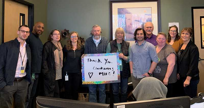 COURTESY PHOTO - Clinic staff members at Clackamas Volunteers in Medicine gather to thank Clackamas County employees for their recent fundraisers and over $500 donation.