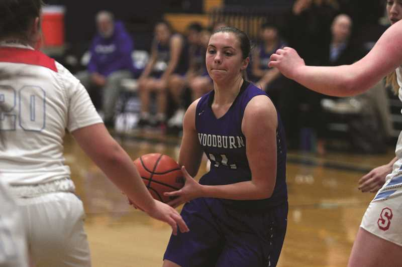 PMG PHOTO: PHIL HAWKINS - Woodburn senior Willow Neshem 22 points, including 6-of-8 shooting from 3-point range, in the Bulldogs 78-61 loss to Valley Catholic in the opening round of the SCTC Holiday Classic on Thursday.