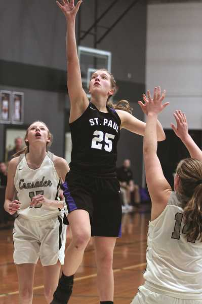 PMG PHOTO: PHIL HAWKINS - The St. Paul Buckaroos were able to survive against No. 3 Burns despite senior captain Erin Counts picking up four early fouls and sitting out most of the third quarter. The Bucks beat the Hilanders 56-49 and went on to win the Green Bracket at the Crusader Classic on Saturday.