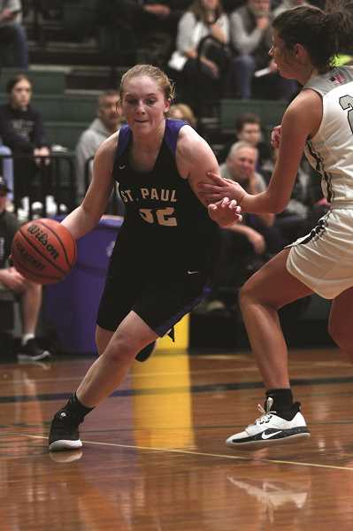 PMG PHOTO: PHIL HAWKINS - St. Paul junior Mary Davidson scored in double digits in the final two games of the tournament, netting 14 and 13 points against Salem Academy and Burns, respectively.