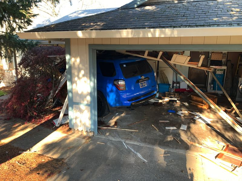WASHINGTON COUNTY SHERIFF'S OFFICE PHOTO - A stolen Toyota 4 Runner sits wedged through the wall of a home in Aloha after a series of hit-and-run crashes in November 2019.
