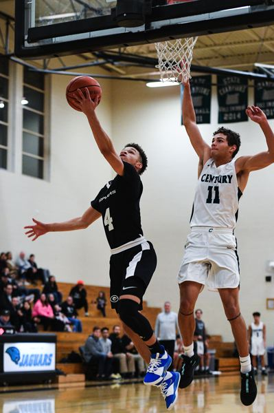PMG PHOTO: CHRIS OERTELL - Greshams Jaylen Welch (4) attacks the basket during a holiday tournament at Century High. The Gophers are off to a 7-1 start heading into their league opener Thursday night.