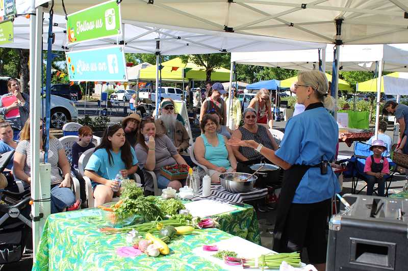 2018 PMG FILE PHOTO - Deborah Ulrich demonstrates a Food Hero recipe using ingredients bought at the Oregon City Farmers Market.