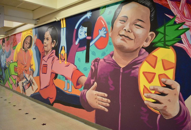 PMG PHOTO: TERESA CARSON - This mural by local artist Axex Chiu graces the hall at Davis Elementary School. Chiu will teach teens about creating characters and drawing comics at a workshop Saturday, Jan. 11, at the Rockwood Library.