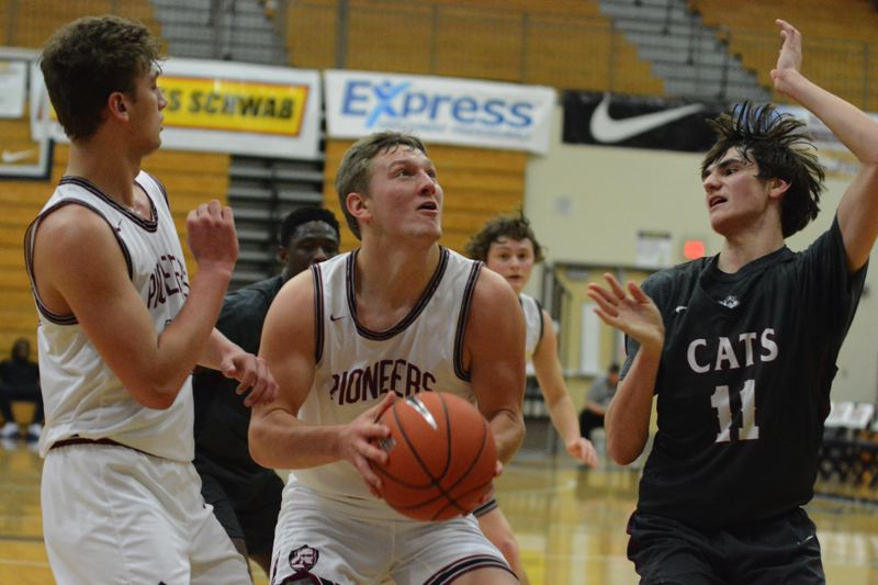PMG PHOTO: DAVID BALL - Sandys Colby Carson looks for a path to the rim during the first quarter of Thursdays loss to Mount Spokane.