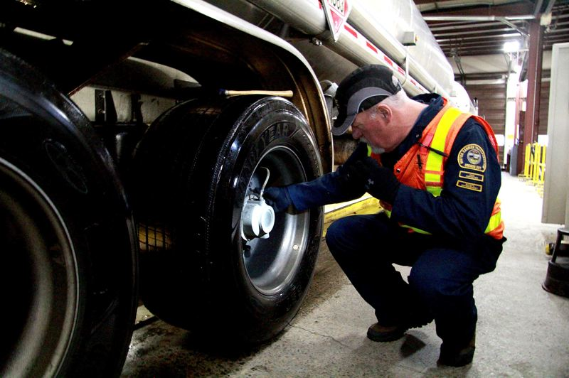 OREGON CAPITAL BUREAU/SAM STITES - ODOT inspector Don McCloskey checks a truck during a recent stop. Brakes and lighting are the two most common issues found in routine inspections completed by ODOT compliance specialists.