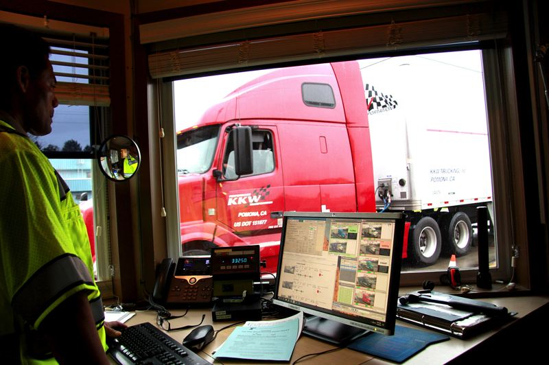OREGON CAPITAL BUREAU/SAM STITES - Weighmaster Tom Avila weighs a Freightliner tractor-trailer as it moves across the scales located at the Woodburn port of entry.