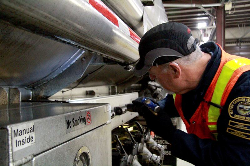 OREGON CAPITAL BUREAU/SAM STITES - Compliance specialists are expected to complete around 516 level one inspections each year, which include a 360-degree sweep of each truck to check for issues and ensuring both the driver and truck's documentation is complete.
