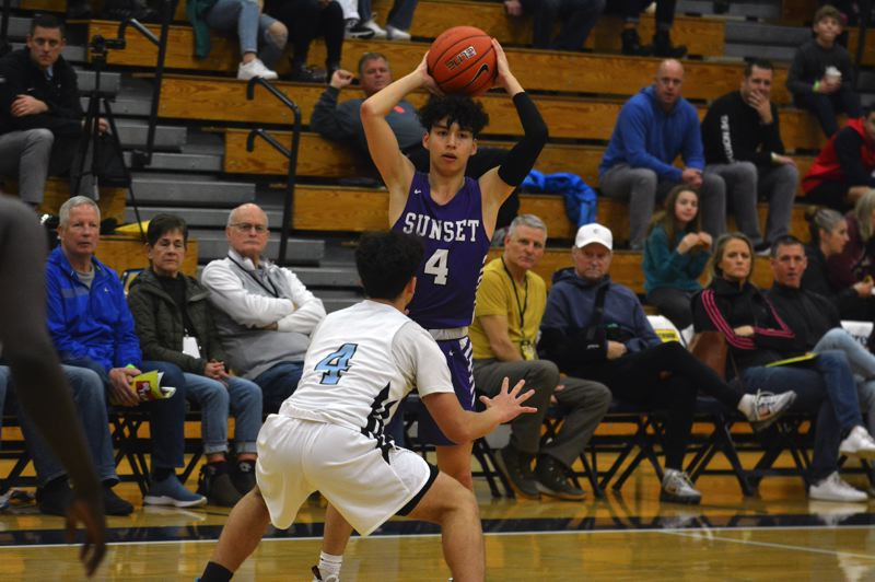 TIMES PHOTO: MATT SINGLEDECKER - Sunset senior guard Braeden Sato scored a team-high 26 points and dished out five assists against De La Salle.