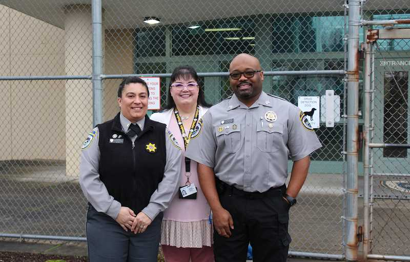 PMG PHOTO - From left, Correctional Lt. Nina Ervin, Assistant Superintendent for Correctional Rehabilitation Christine Popoff and Correctional Sergeant Essex Houston pose for a photo at Coffee Creek Correctional Facility.
