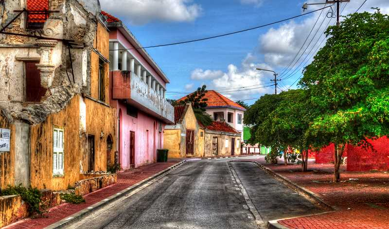 LON AUSTIN/CENTRAL OREOGNIAN - Like Aruba, Curacoa is a Dutch island. The capital city of Williamstad is filled with colorful buildings. Just a short walk from the tourist areas brings you to deserted streets away from the crowds.