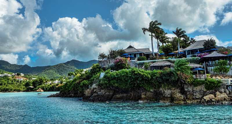 LON AUSTIN/CENTRAL OREGONIAN - An expensive resort perches on a small cliff in Antigua. A British Island, Antigua is filled with hostorical buildings as well as having beautiful ocean scenery.