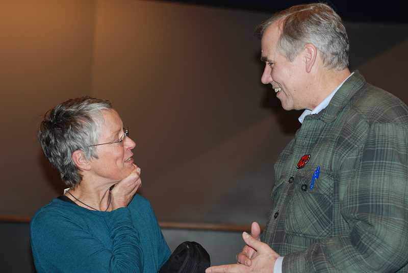 TERESA JACKSON/MADRAS PIONEER - Gail Snyder, executive director of Coalition for the Deschutes, talks with U.S. Sen. Jeff Merkley after his town hall event Saturday, Jan. 4, in Madras.