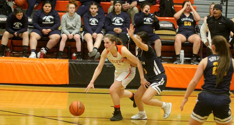 STEELE HAUGEN - Karmen Horat drives hard to the basket during the Lady Dawgs' 64-54 home loss to Sheridan Jan. 4.