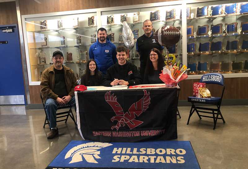 COURTESY PHOTO - Hillsboro High School's Nate Smith poses for a photo with his family, dad Matthew, sister Cassidy and mom Tiffany, along with head coach Dan Shuff and Hilhi athletic director Steve Drake, during his letter of intent signing last month outside the gymnasium at Hillsboro High School.