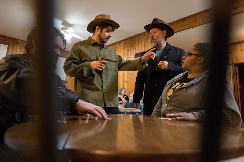PMG PHOTO: JAIME VALDEZ - Erik Montague, portraying a drunk, has an exchange with Richard Cohn-Lee as Dr. Henry Jekyll, during rehearsal of  'The Strange Case of Dr. Jekyll & Mr. Hyde' by the Experience Theatre Project at the Beaverton Masonic Lodge.