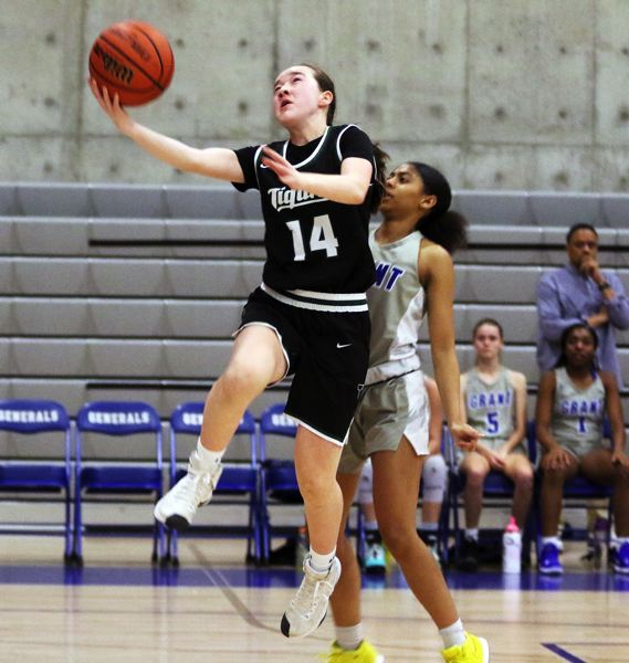 PMG PHOTO: DAN BROOD - Tigard High School freshman Hailey Shimojima (14) goes up to the basket after coming up with a steal during the Tigers' game at Grant on Tuesday.