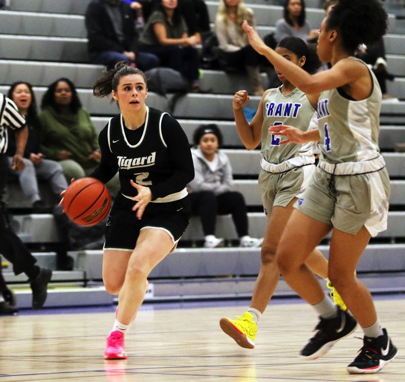 PMG PHOTO: DAN BROOD - Tigard High School senior Kennedy Brown (left) looks to make a pass inside during the Tigers' non-league game at Grant on Tuesday.