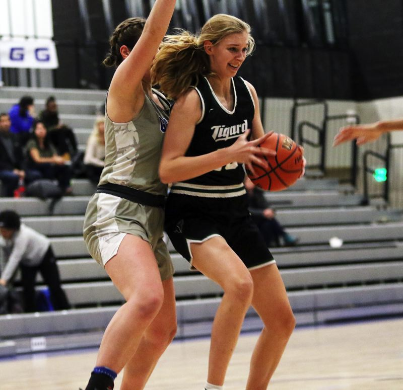 PMG PHOTO: DAN BROOD - Tigard High School sophomore Sarah Lamet (right) battles inside against Grant junior Schulyer Berry during Tuesday's non-league contest.