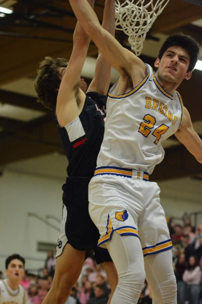 PMG PHOTO: DAVID BALL - Barlows Joey Wolcott goes into the air to challenge a shot in the first quarter.