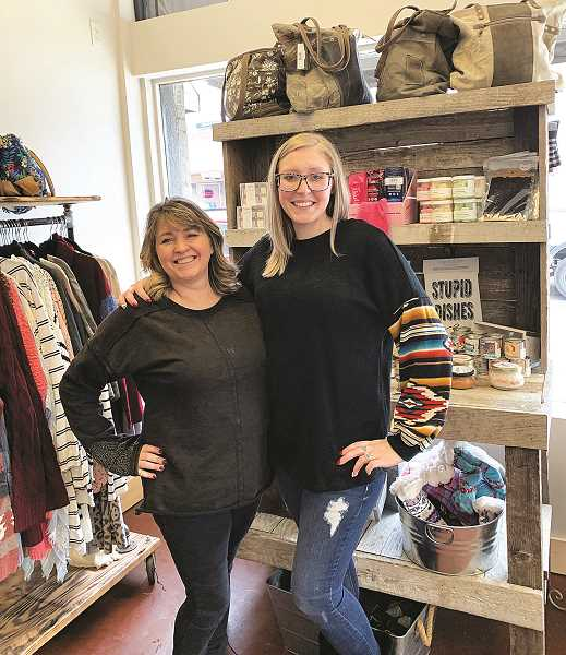 PMG PHOTO: CAROL ROSEN - Mary Wilson and her daughter Brittany Gipe show off their new hutch at ParLi Boutique.