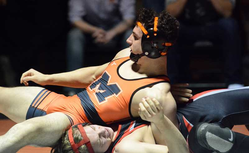 PMG PHOTO: DEREK WILEY - Molalla senior Maximus Tate pins Santiam Christian's Riley Rothrock in the second period Tuesday night.